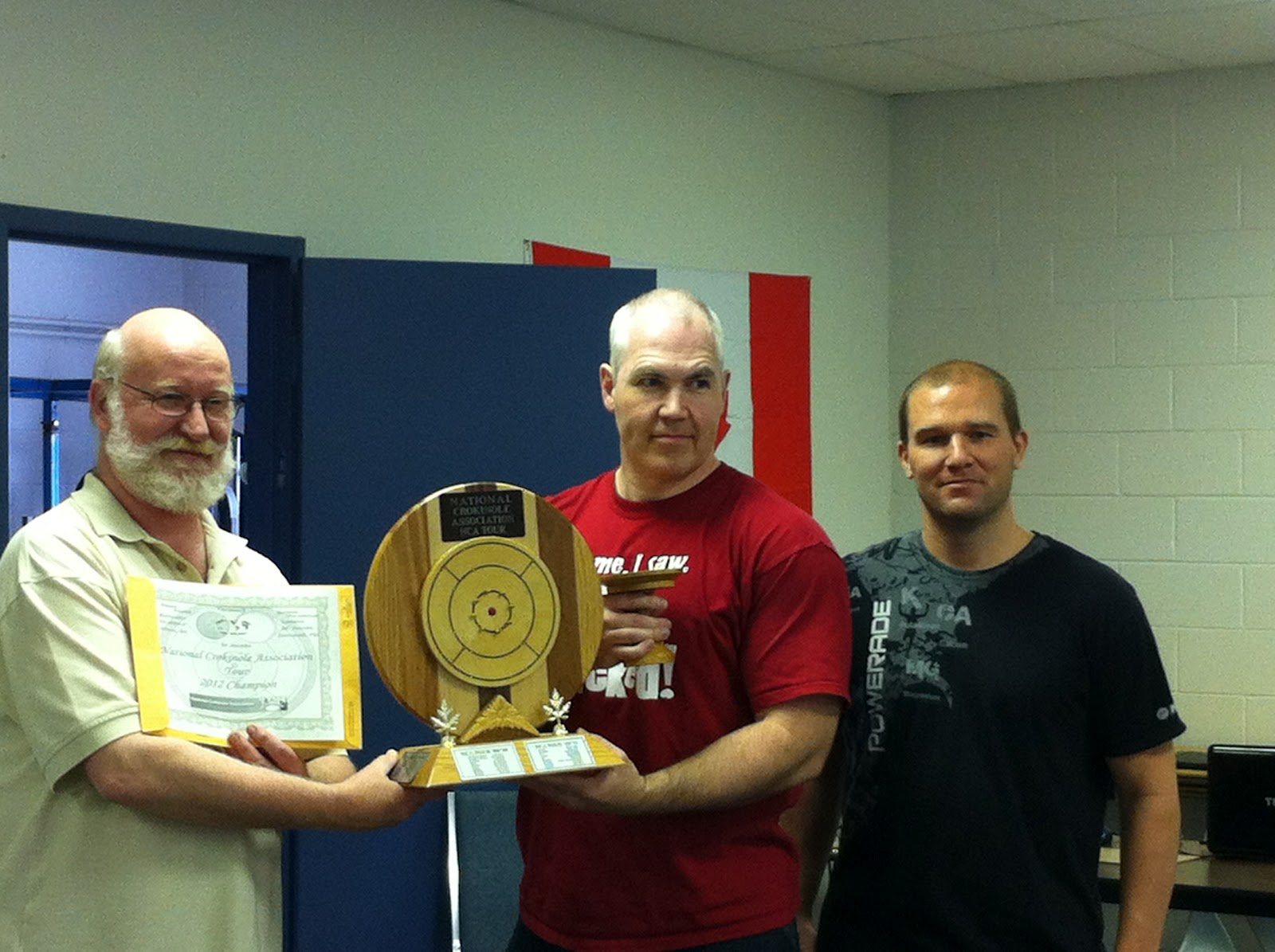 Brian Cook (centre) accepts the NCA's top prize from NCA Executives, Eric Miltenburg (left) and Greg Matthison (right).