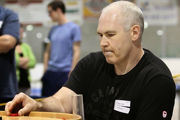 Brian Cook in action during the finals of the 2014 World Crokinole Championships. Photo credit: Bill Gladding