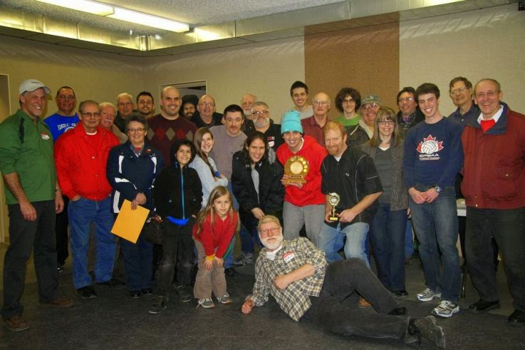 A great group shot of the competitors after the action completed at the 2015 Golden Horseshoe Crokinole Tournament. Photo Credit: Eric Miltenburg