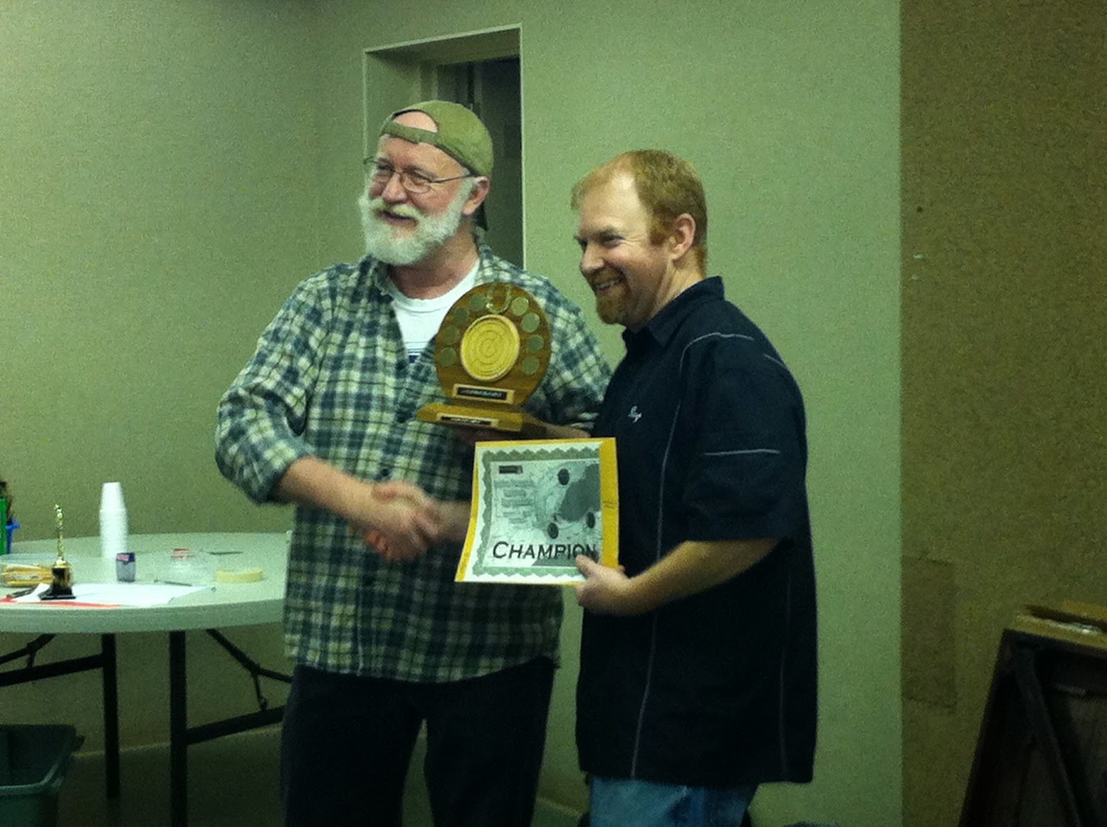 Ray Beierling accepts the title from Eric Miltenburg, his 3rd-straight tournament victory this year.