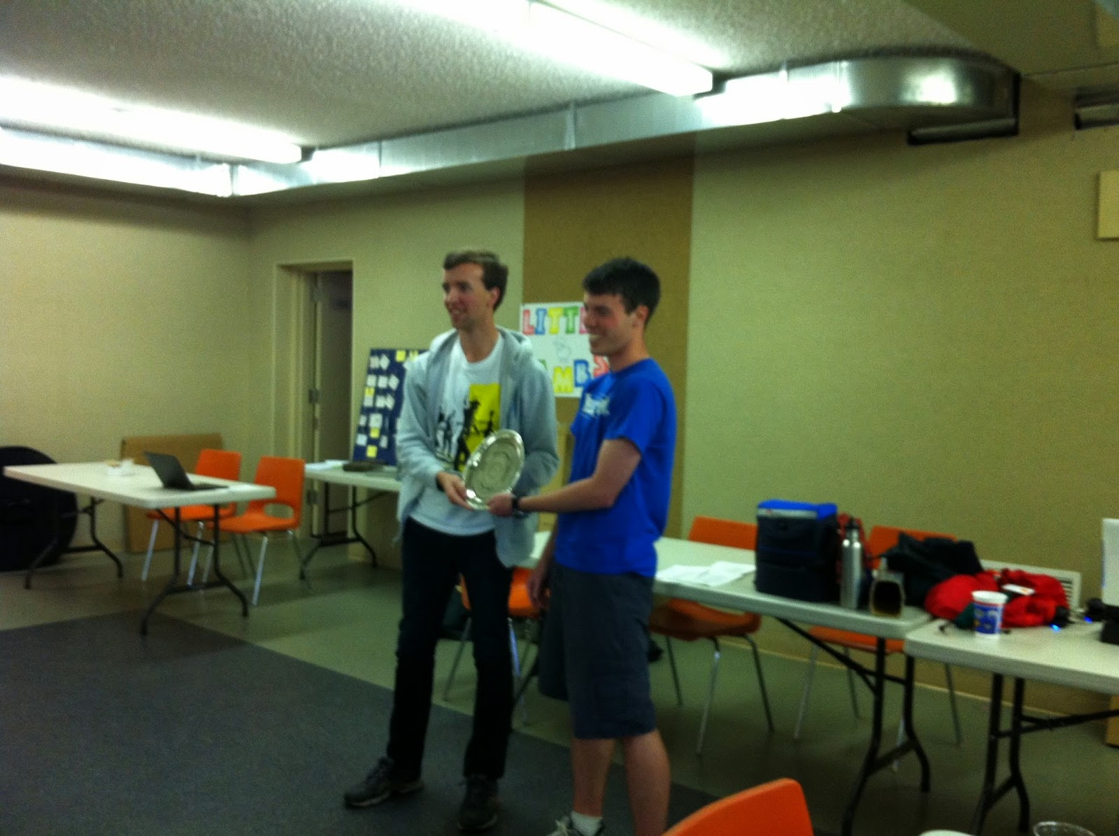 Nathan Walsh accepts the 1st Place prize from Quin Erzinger