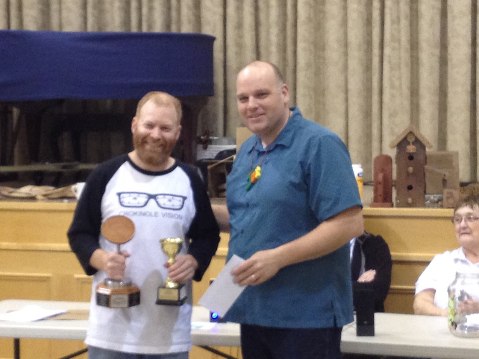 Ray Beierling accepts top prize from tournament emcee, Joe Richards