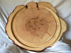 crokinole board carved from a single tree stump