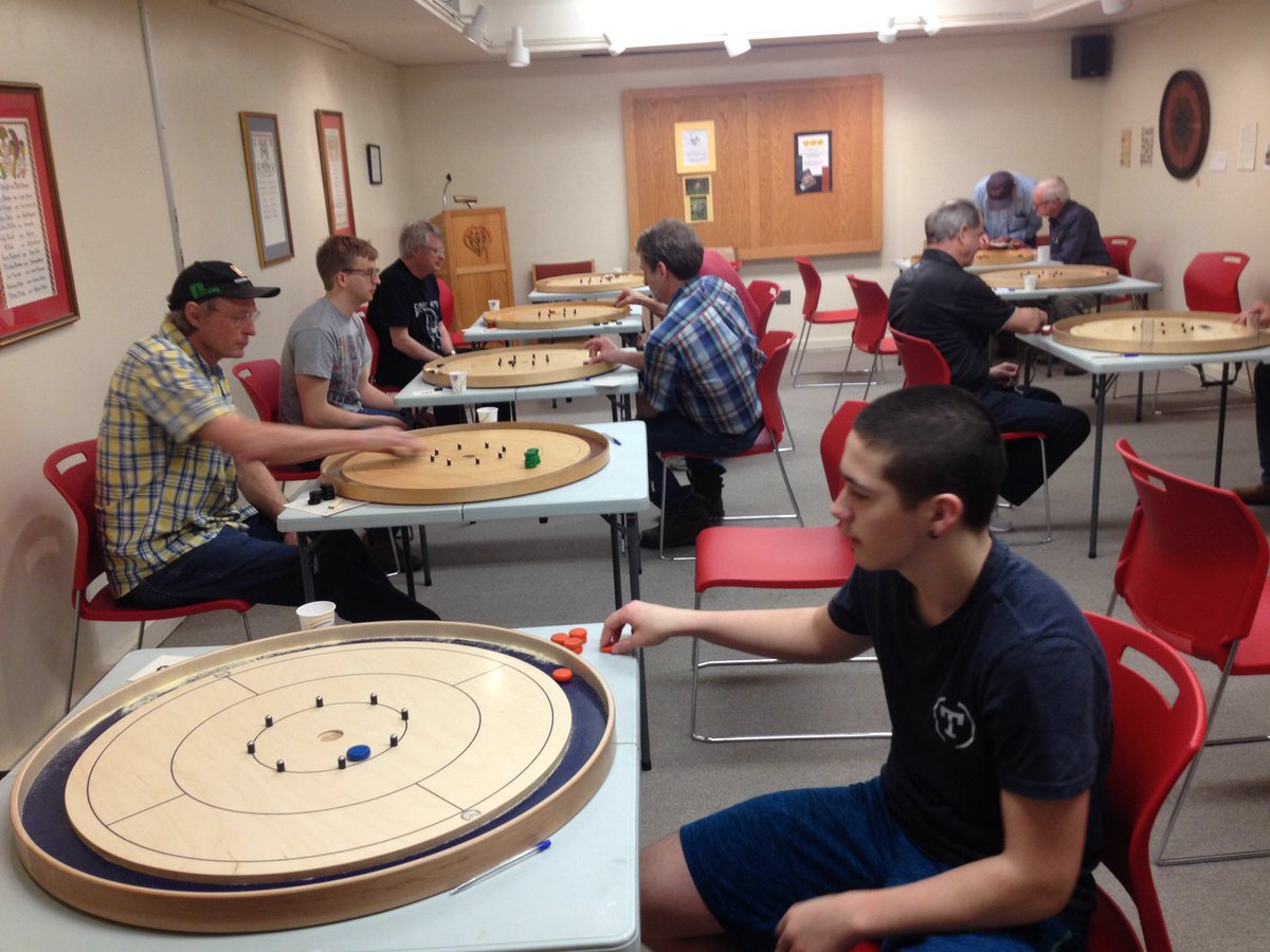 People playing crokinole