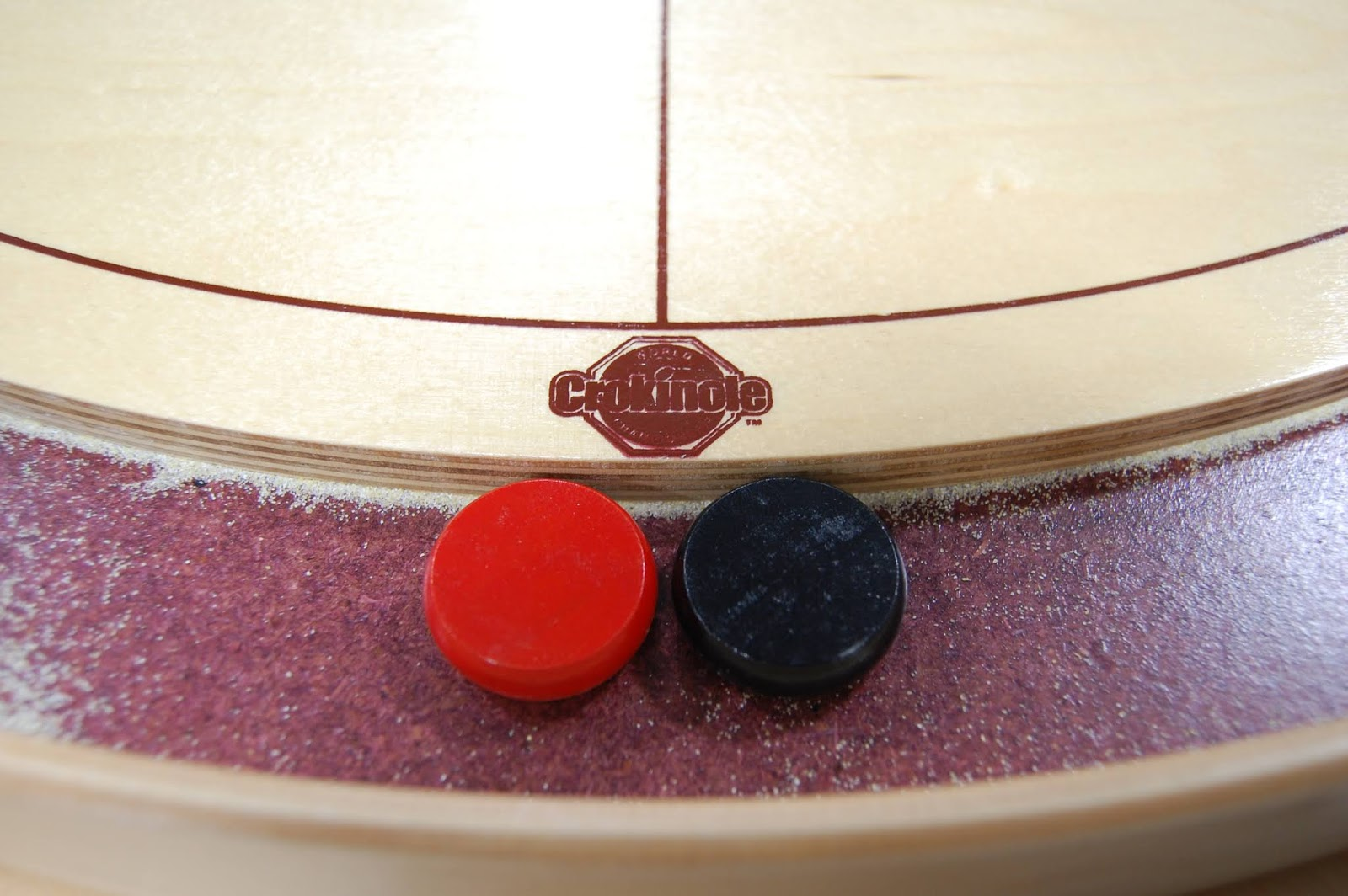 Crokinole pieces on board