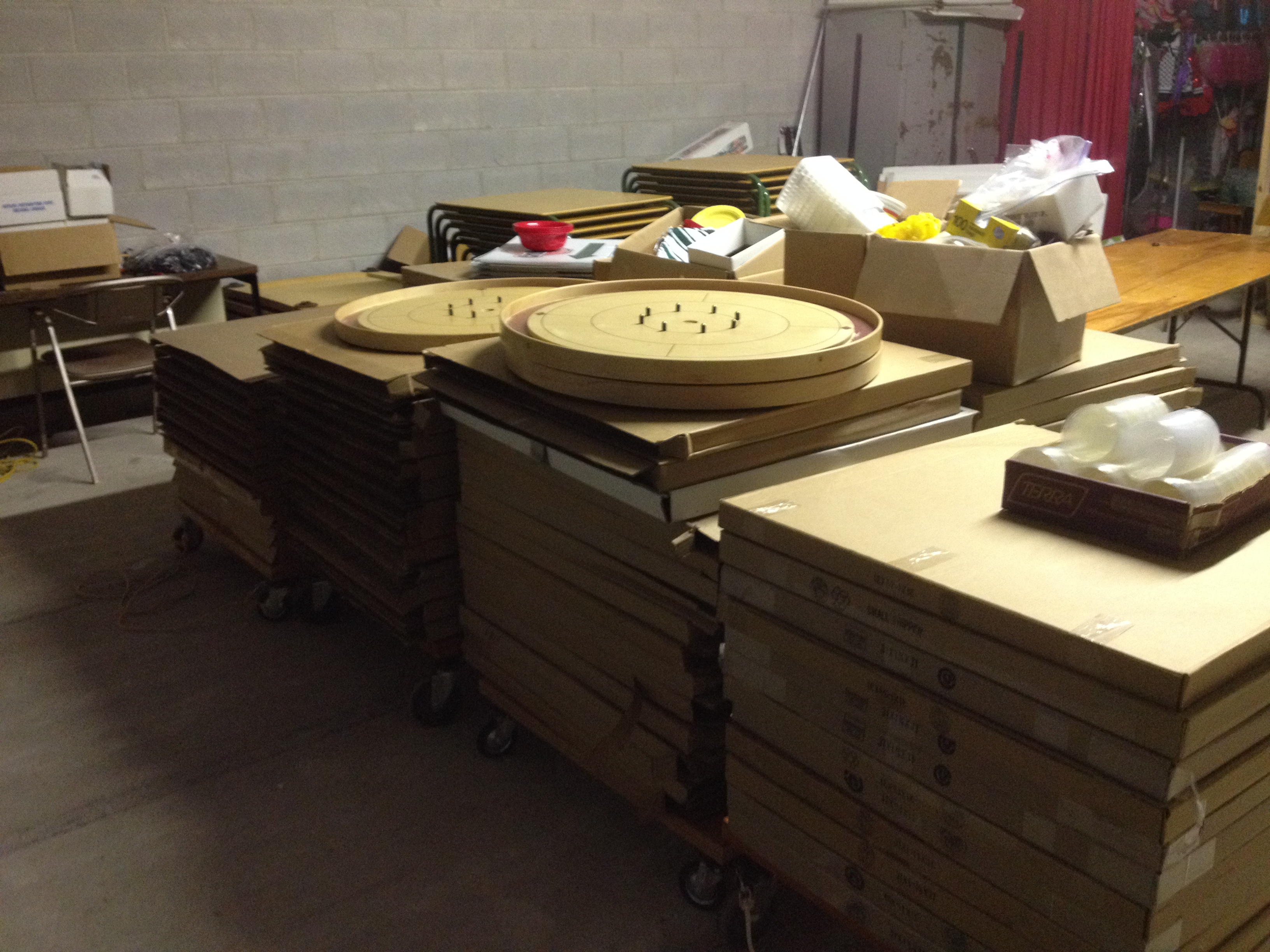 Multiple stacks of crokinole boards sit in storage after being packed up following the 2019 WCC event