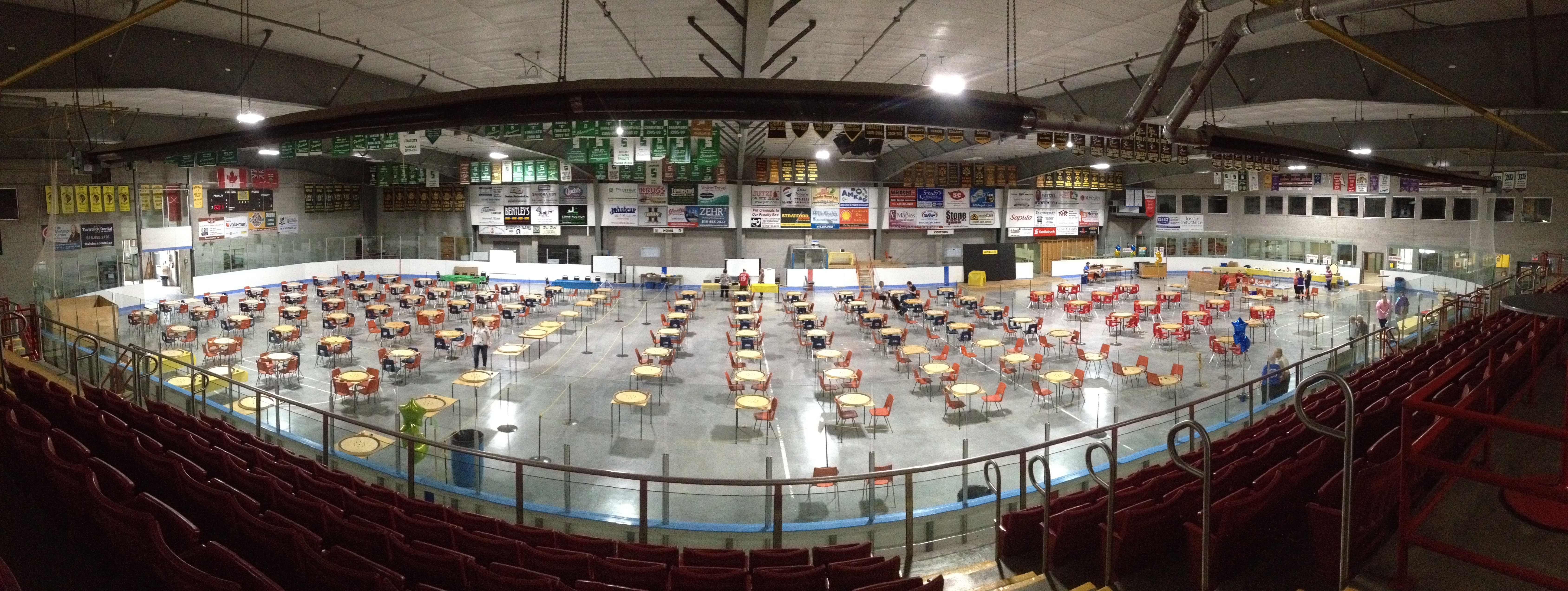 Panaramic aerial shot of the Tavistock arena floor showing over 100 tables and crokinole boards