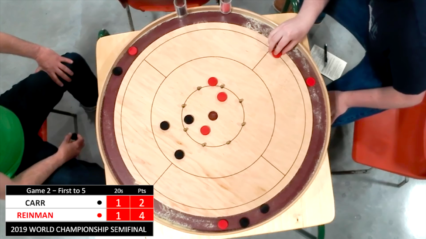 A overhead snapshot during the Carr/Reinman semifinal showing a cluttered board with 6 discs in play