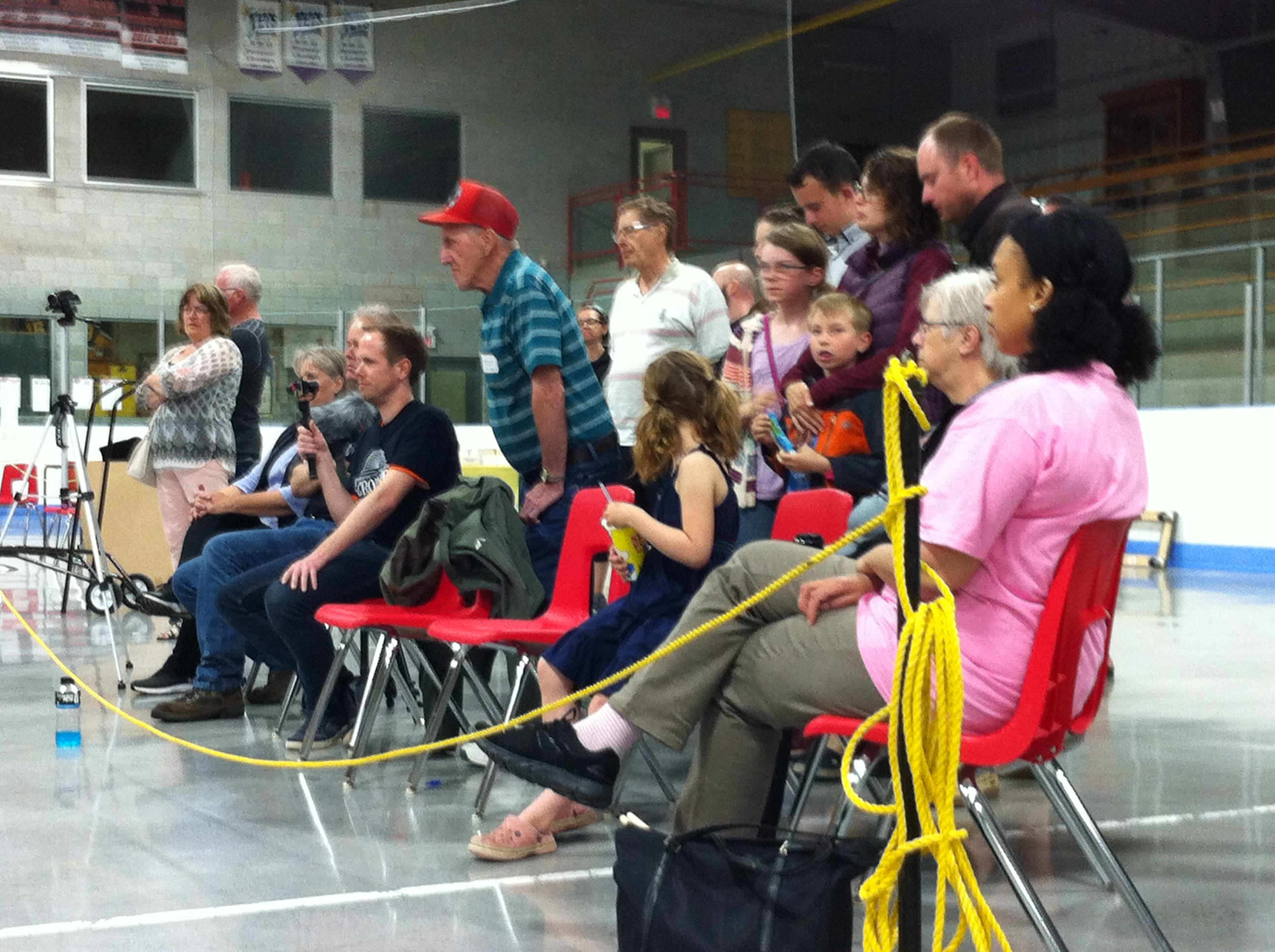 Spectators watch Justin Slater play Roy Campbell during the semifinals