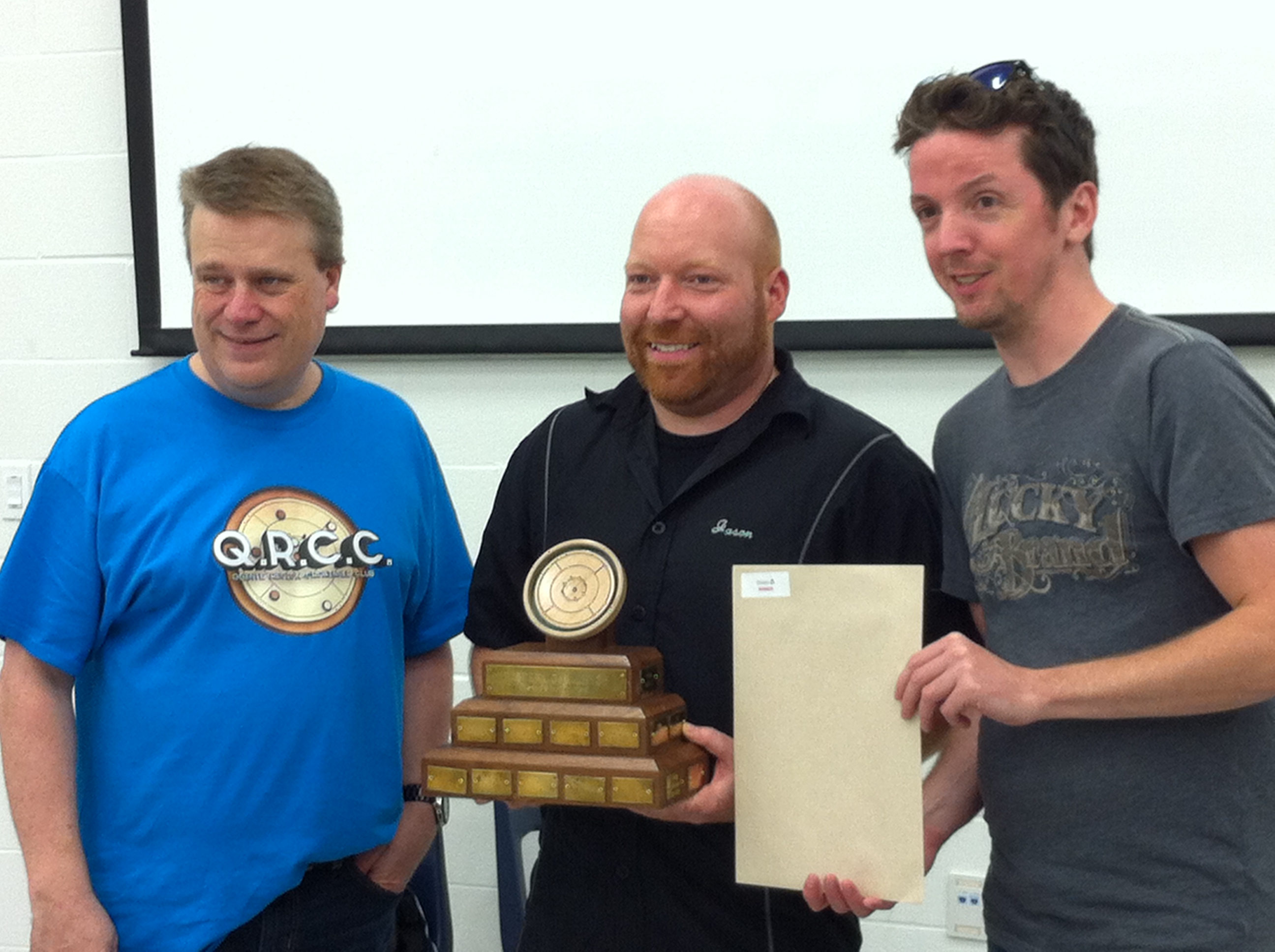 Jason Beierling receives championship trophy from event organizers, Chris Gorsline and Matt Brown